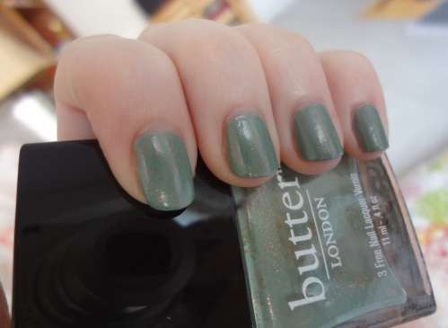butter london two fingered salute close-up